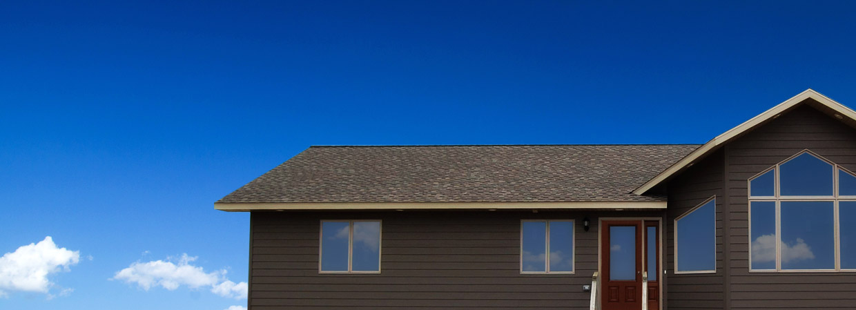 Brown house with blue sky